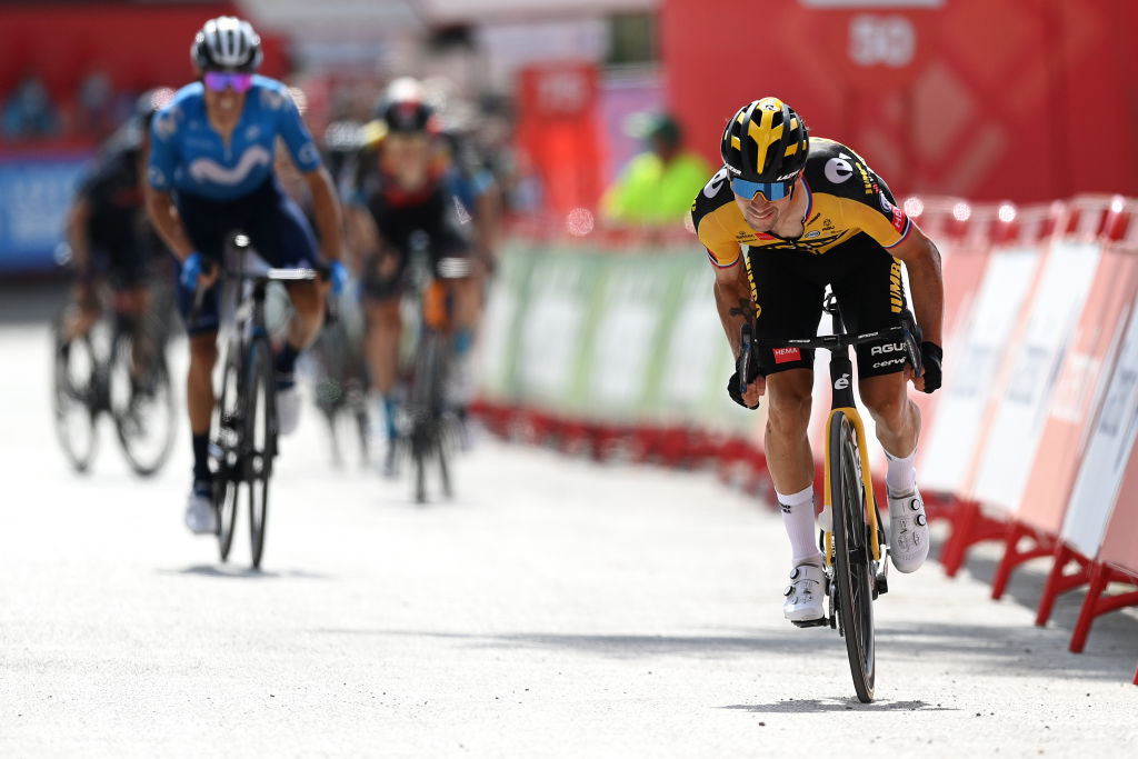 VALDEPEAS DE JAN SPAIN AUGUST 25 Primoz Roglic of Slovenia and Team Jumbo Visma sprint at finish line to win the stage during the 76th Tour of Spain 2021 Stage 11 a 1336km stage from Antequera to Valdepeas de Jan 1009m lavuelta LaVuelta21 on August 25 2021 in Valdepeas de Jan Spain Photo by Stuart FranklinGetty Images