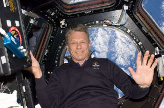 Astronaut Piers Sellers is pictured floating aboard the International Space Station, in front of a window overlooking Earth in May 2010. Sellers, a climate scientist, died on Friday, Dec. 23, 2016.