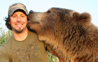 """Naturalist Casey Anderson and his adopted bear Brutus. Brutus was the best """"man"""" at Anderson's wedding."""