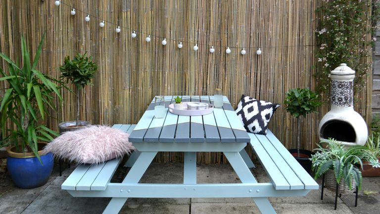 Garden upcycle idea with paint effect on old picnic table