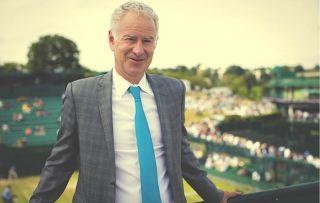 John McEnroe enjoys his commentary job at Wimbledon.