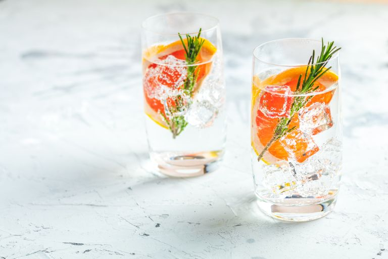 glasses of flavoured gin and rosemary sprigs