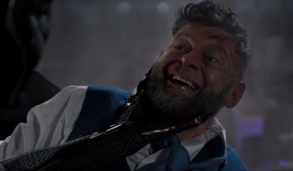 Black Panther holds Ulysses Klaue by his neck