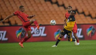 Bevan Fransman and Khama Billiat challenge for the ball