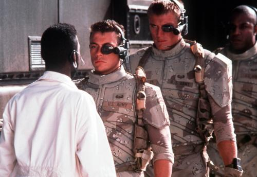 Universal Soldier - Dolph Lungren's state-of-the-art cyborg soldier looms over co-star Jean-Claude Van Damme.
