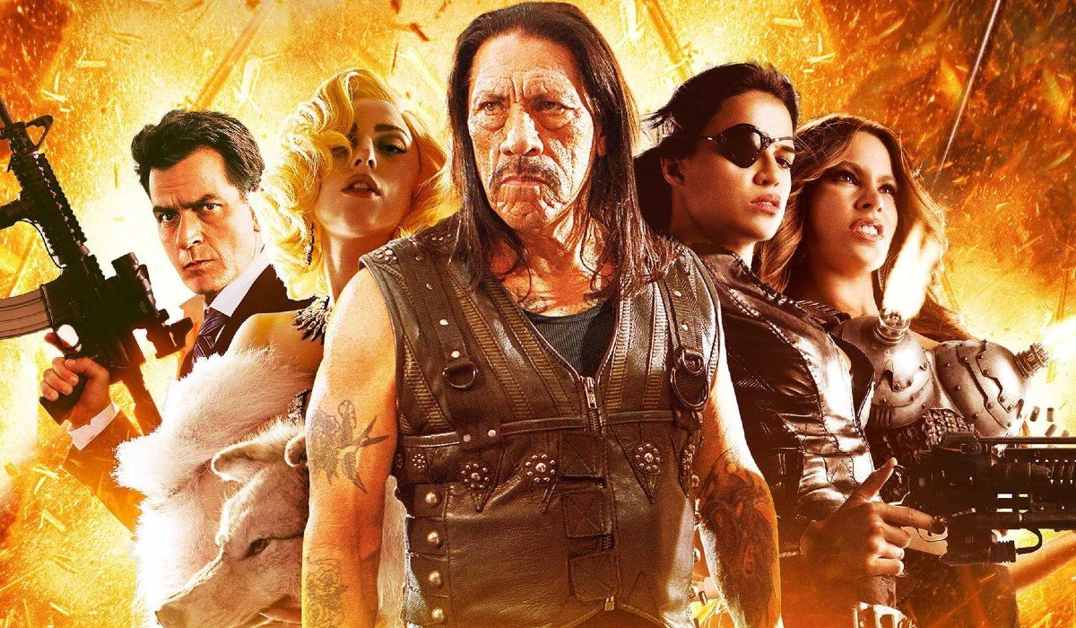 Machete Kills the cast stands in front of an explosion
