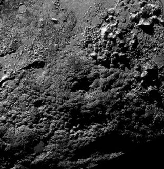 A possible ice volcano on Pluto (visible at center) is seen in this NASA image, captured by the New Horizons spacecraft, released on Nov. 9, 2015.