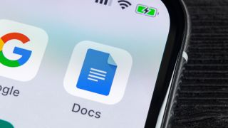 How to get dark mode in Google Docs - A phone showing the Google Docs icon
