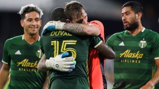 Portland Timbers goalkeeper Steve Clark and defender Chris Duvall embrace after defeating the Philadelphia Union in the MLS is Back tournament on August 5, 2020, at the ESPN Wide World of Sports Complex in Orlando, FL.
