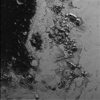 A second mountain range on Pluto that rises from the dwarf planet's heart-shaped region, nicknamed Tombaugh Regio, is seen in this stunning image from NASA's New Horizons spacecraft. NASA unveiled the image on July 21, 2015.