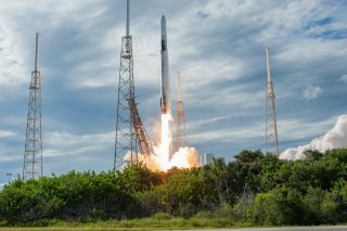 A SpaceX Falcon 9 rocket with the cargo ship CRS-18 Dragon for NASA takes off from the Air Force Station Cape on July 25th Canaveral in Florida, 2019, to deliver to the International Space Station.
