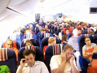 Passengers on an airplane, air rage, behavior