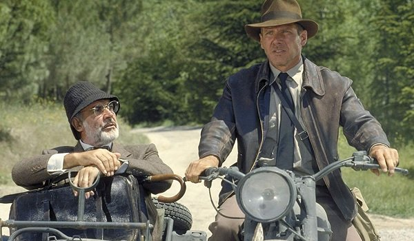 Indiana Jones and the Last Crusade Sean Connery and Harrison Ford thinking on a motorcycle