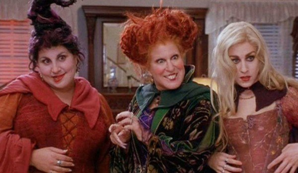 Hocus Pocus the Sanderson sisters looking excited and apprehensive in a kitchen