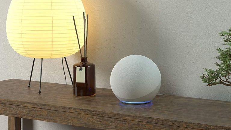 Best smart speaker Amazon Echo on side table with reed diffuser and lamp