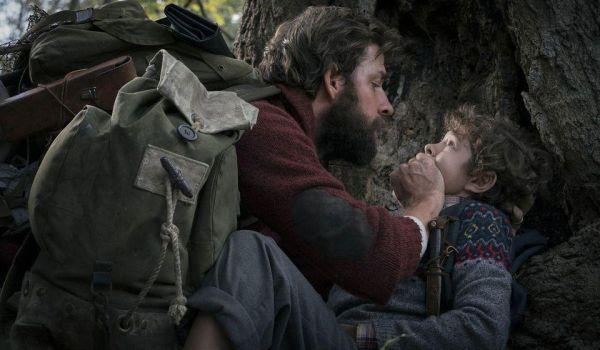 John Krasinski keeping his son quiet in A Quiet Place