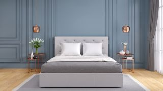 How to optimize your bedroom for sleep: A stylish bedroom for sleep decorated with blue walls to promote calm