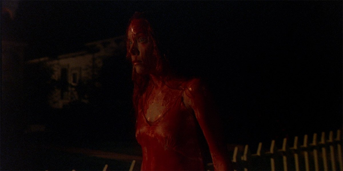 Sissy Spacek as Carrie White covered in blood walking home in Carrie