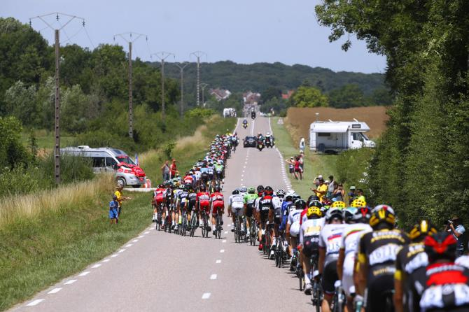 The Tour de France peloton was lined out on the country roads