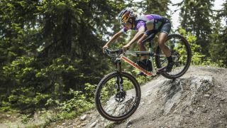 Emily Batty rides the new Canyon Lux Trail downcountry bike