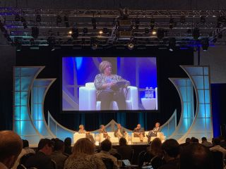 Camille Burch moderates a digital signage panel at AVEC 2019.