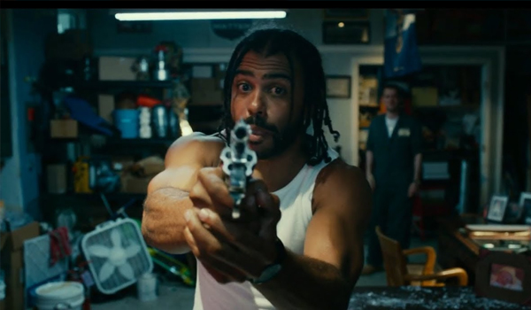 Daveed Diggs as Colin freestyles while holding a gun in Blindspotting