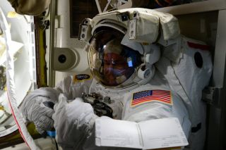 NASA astronaut Scott Kelly is seen in his NASA spacesuit on the International Space Station on Oct. 27, 2015 ahead of his first spacewalk on Oct. 28 with crewmate Kjell Lindgren, also of NASA.