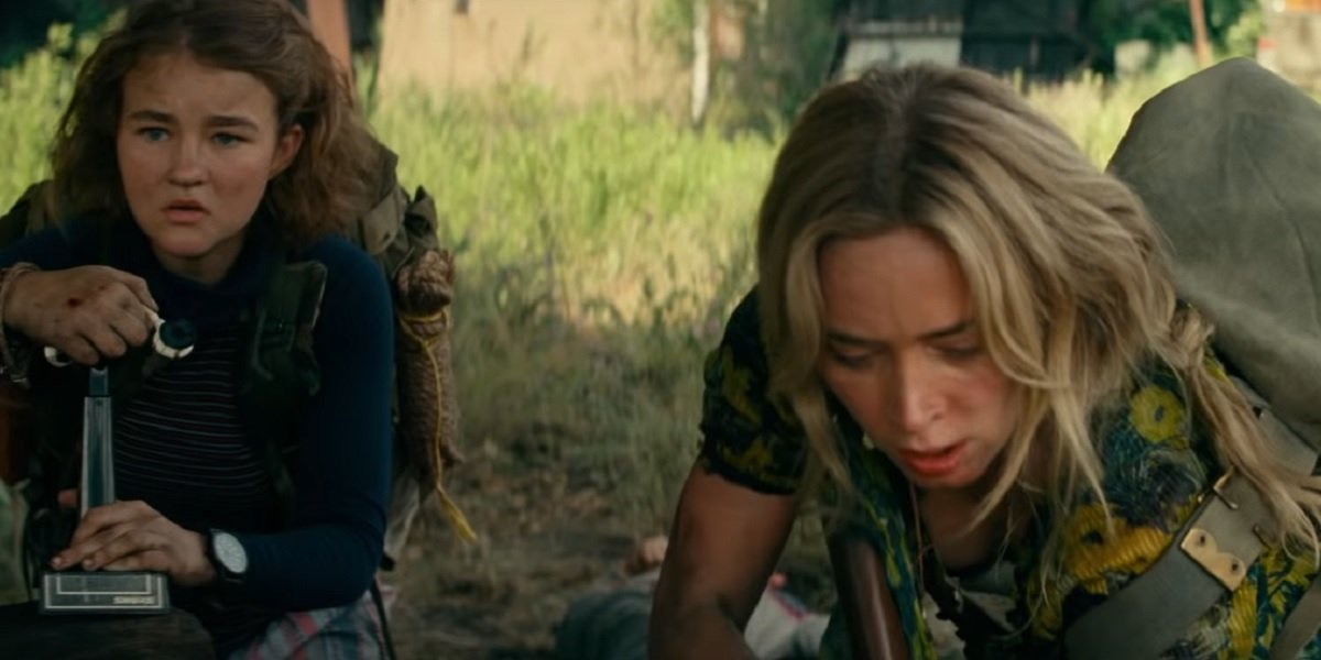Emily Blunt and Millicent Simmonds hunched down in A Quiet Place 2