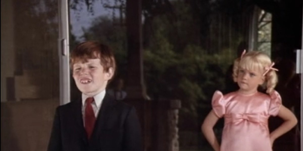 Susan Marie Olsen and Michael Lookinland as Bobby and Cindy Brady in The Brady Bunch