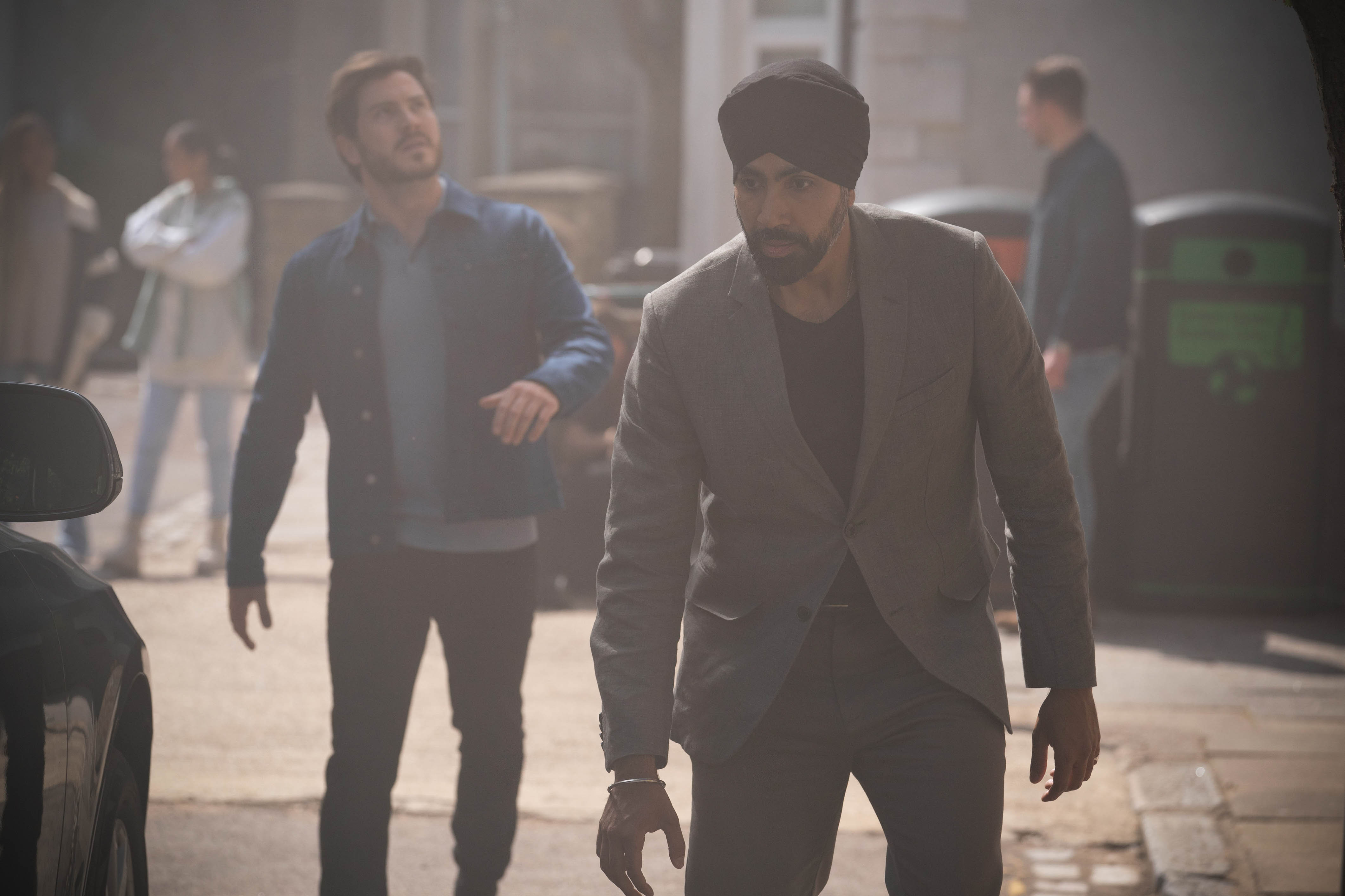 Kheerat Panesar and Gray Atkins head into the Mitchell house in EastEnders