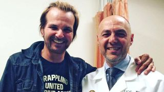 Rikki Rockett with Dr Ezra Cohen