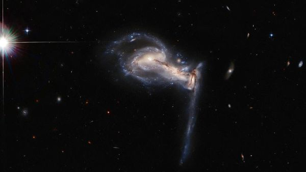 NASA has glimpsed our galaxy's fate in three-way galactic brawl