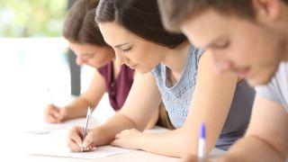 Teenage students writing