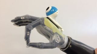 An artificial hand fitted with a camera