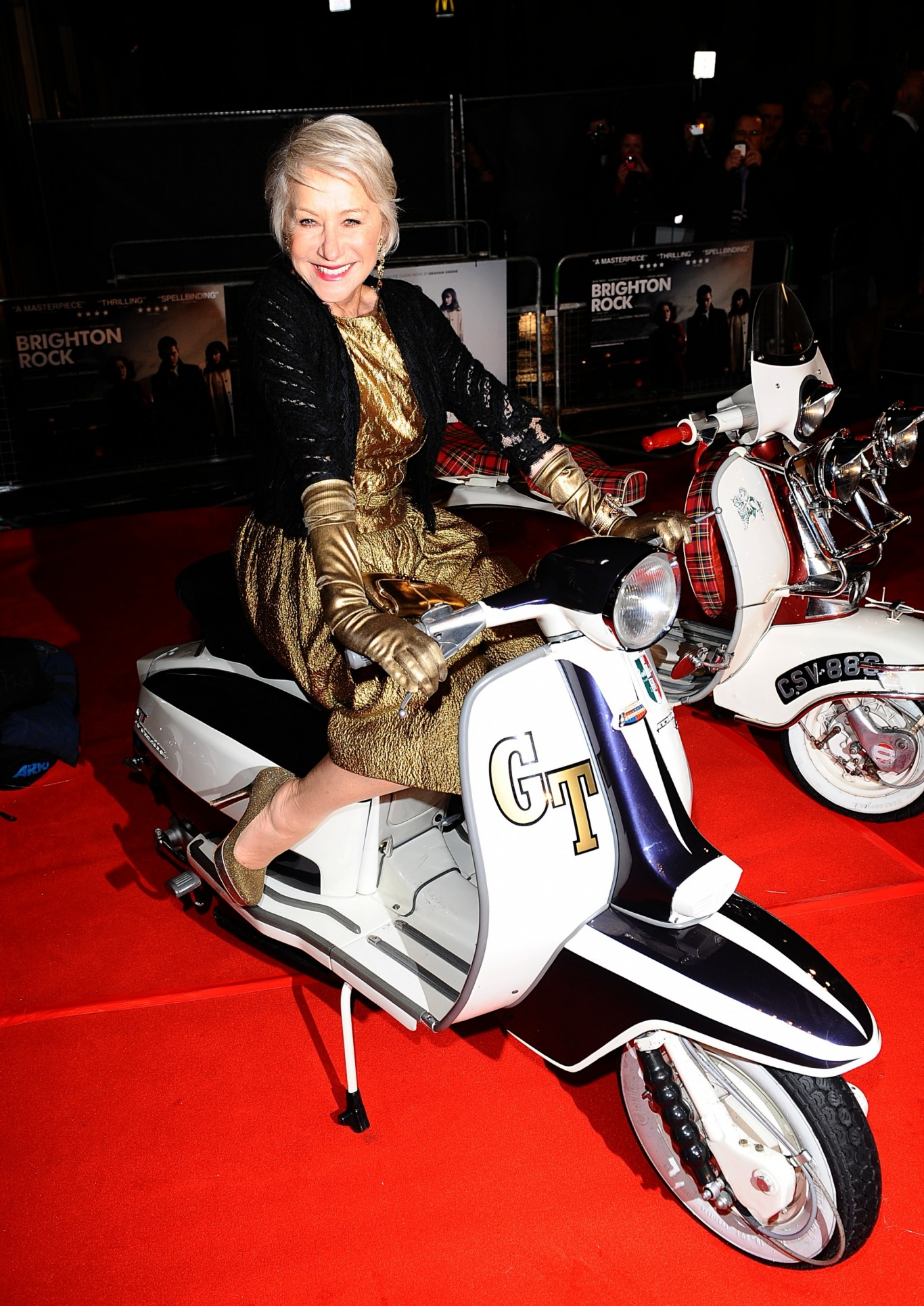 Helen Mirren poses on a scooter at the premiere of Brighton Rock in 2011