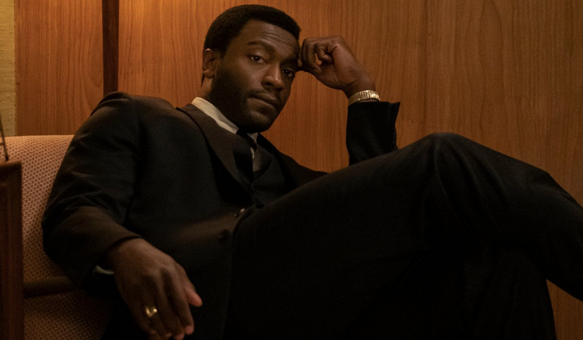 Aldis Hodge sits well dressed in the hotel room in One Night In Miami.