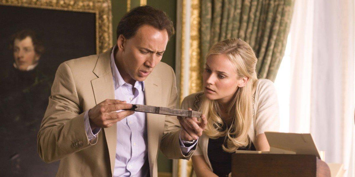 Nicolas Cage, Diane Kruger reading a clue National Treasure: Book of Secrets