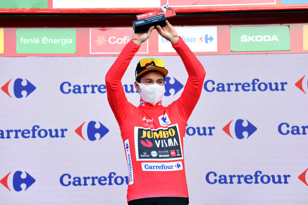 SUANCES SPAIN OCTOBER 30 Podium Primoz Roglic of Slovenia and Team Jumbo Visma Red Leader Jersey Celebration Mask Covid safety measures Trophy during the 75th Tour of Spain 2020 Stage 10 a 185km stage from Castro Urdiales to Suances lavuelta LaVuelta20 La Vuelta on October 30 2020 in Suances Spain Photo by Justin SetterfieldGetty Images