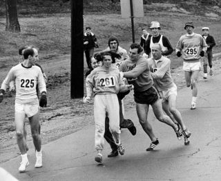 Kathrine Switzer running the Boston Marathon in 1967. At one point during the race, an official tried to push Switzer off the course.