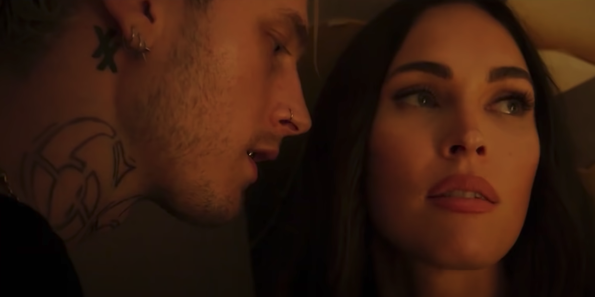 Machine Gun Kelly stands close to Megan Fox in a scene from 'Midnight in the Switchgrass'