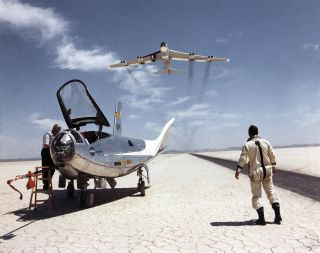 This classic 1969 photo shows the Dryden NB-52B flying over the HL-10 lifting body aircraft and its pilot, Bill Dana.