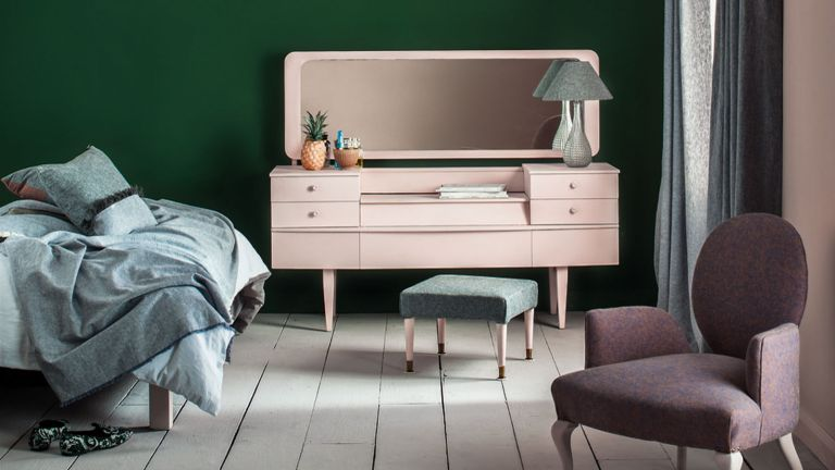 bedroom with dressing table with drawers and a chair