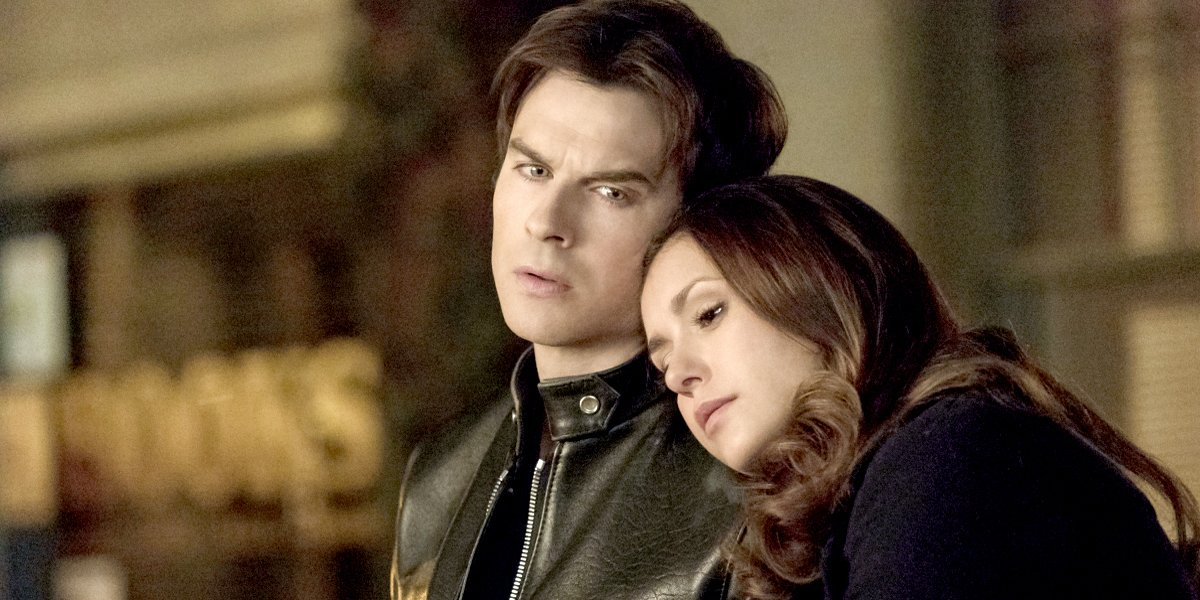 The Vampire Diaries Elena leans on Damon shoulder The CW