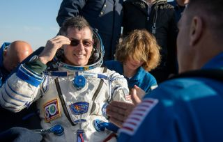 NASA astronaut Shane Kimbrough rests outside the Soyuz M-02 spacecraft shortly after he and Russian cosmonauts Sergey Ryzhikov and Andrey Borisenko touched down on the steppes of Kazakhstan April 10, 2017, after 173 days in space.