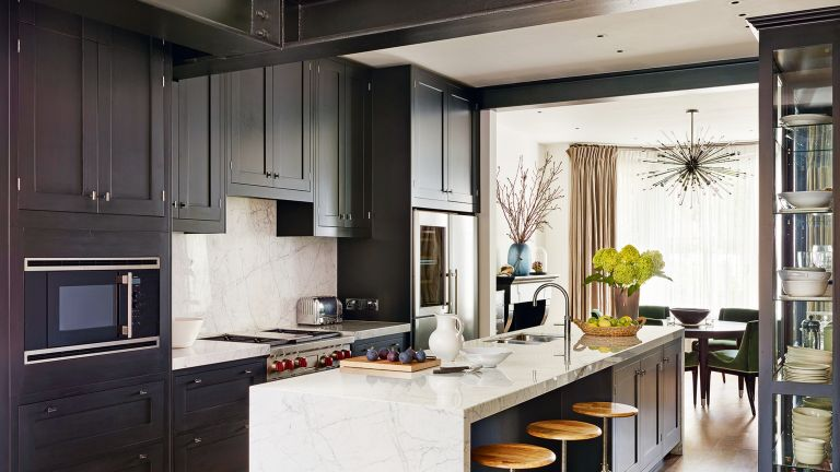 Kitchen with dark grey cabinets