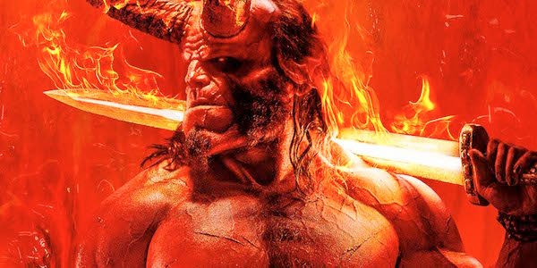 David Harbour as Hellboy holding flaming sword
