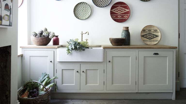 farmhouse decor ideas with decorative baskets on wall in a kitchen