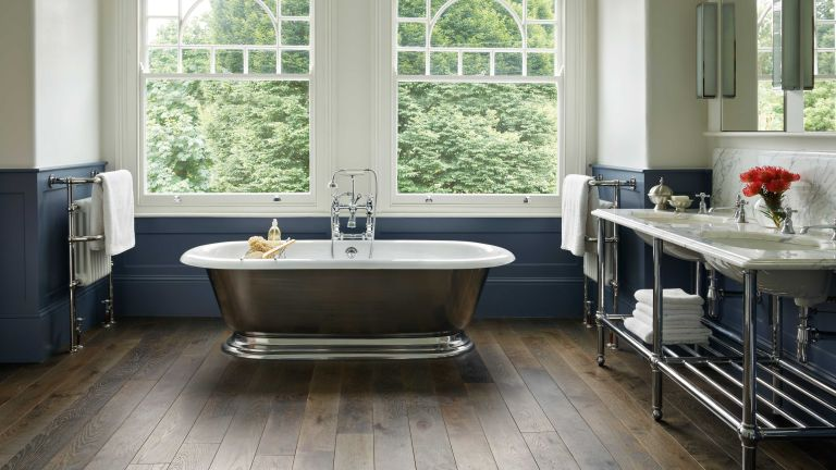 plumbing problems: panelled bathroom with freestanding bath