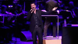 A picture of Serj Tankian performing with the CSUN Symphony