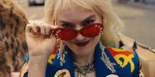 Harley Quinn wearing sunglasses before eating breakfast sandwich